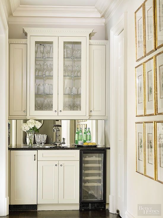 Make entertaining a breeze by building your wet bar just outside the kitchen. The corner location of this bar area allows guests to serve themselves, while darker countertops and a mirror backsplash distinguish it from other parts of the kitchen.