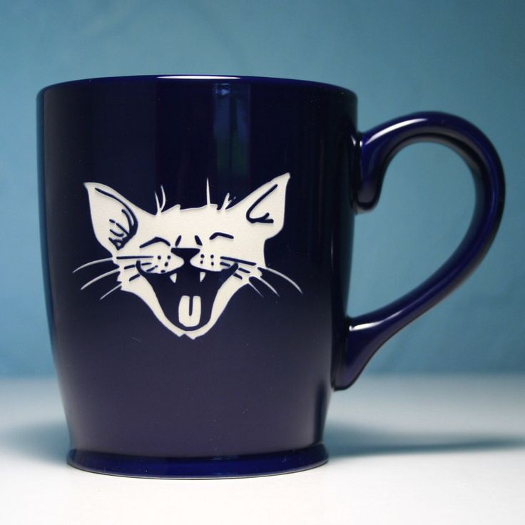 Check out this navy blue laughing cat coffee cup from Bread and Badger