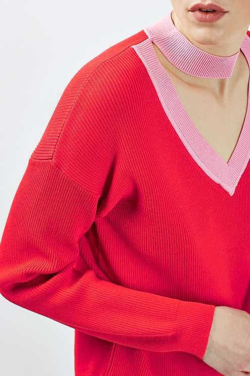 With its bright red colouring and cool choker neck detail, this knit jumper by Boutique goes against the norms. Featuring a flattering V neckline in contrasting light pink to match the choker. A truly unique addition to your winter wardrobe. #Topshop