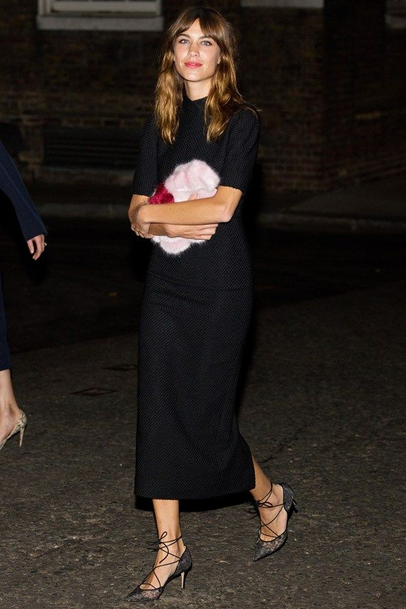 September 15th 2014. Wearing a dress by Emilia Wickstead to the Downing Street London Fashion Week reception.