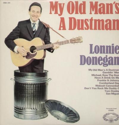 April 1960, Lonnie Donegan, My Old Man's a Dustman.  The King of Skiffel Music. ' My old man's a dustman, he wears a dustman's hat, he wears cor blimey trousers and he lives in a council flat.""
