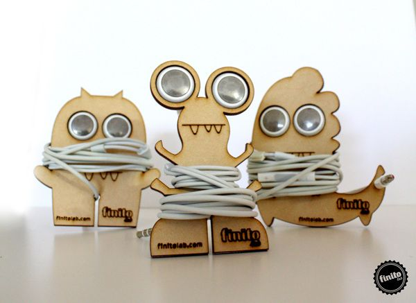 MONSTERS by Finito Lab , via Behance << laser cut earbud holders bobbin aliens