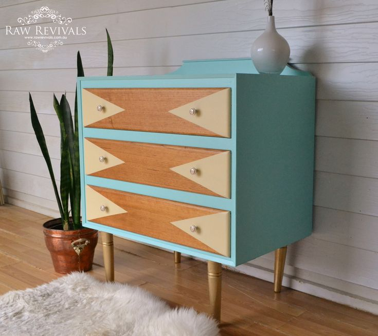Retro Mid Century Aqua Chest of Drawers.  With geometric pastel yellow feature.  www.rawrevivals.com.au