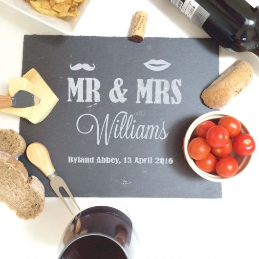 Mr & Mrs Moustache & Lips Cheese Board.  A fun and personalised slate cheeseboard which makes a fantastic personalised wedding gift for any cheese lovers. Can be personalised with a family name and date.  Our Personalised Slate Cheeseboard is beautifully hand-crafted in Yorkshire and makes a fantastic gift any time of the year for a cheese lover.