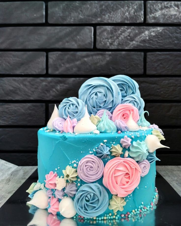 I'm not usually a fan of cakes with miscellaneous stuff piled on (especially with drips) but I do love this one because of the colour scheme and the rosettes on their sides. Really clever and pretty.