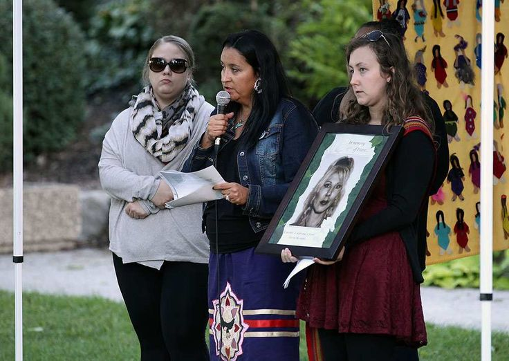 Melissa Thomas, Elayne Isaacs and Katie Baltzer (left and right) hold a photo of Diane Dobson in Dieppe Park as part of the 11th annual National Sisters in Spirit Vigil for the murdered indigenous women across Canada in Windsor on Tuesday, October 4, 2016. The annual event seeks to raise awareness of missing and murdered women.