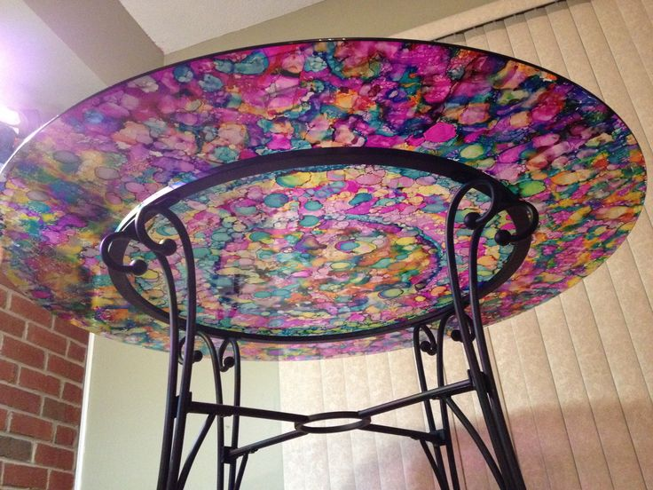 Alcohol ink stained glass table. By Lauren Risi
