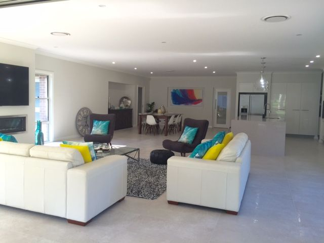 One of our customers, Julie, has shared a photo of the heart of the home in her Bronte Farmhouse Grande Manor. Her home is styled with a neutral backdrop and splashes of peacock blue and citrine yellow. For details on this design see http://mcdonaldjoneshomes.com.au/home-designs/new-south-wales-and-queensland/bronte/floorplans. #living #dining #colour #neutral #neutralbackdrop #citrine #peacock #blue #yellow #acreage #farmhouse #bronte #design