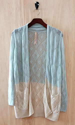 An eye-catching ombre effect makes this cozy cardigan the perfect partner to any outfit. Trend-right colors and a pretty crochet pattern brings the right appeal to this open-front cardigan for warmer months.