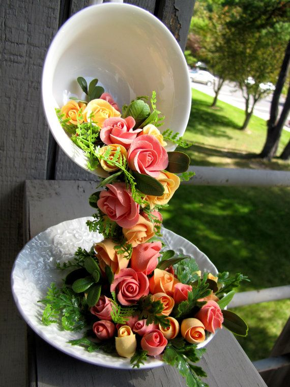 Gravity defying vintage teacup with yellow and peach color roses on Etsy, $150.00