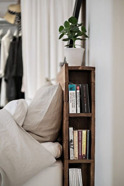 Maybe have the two exposed ends of the sofa table have mini bookshelves like this?