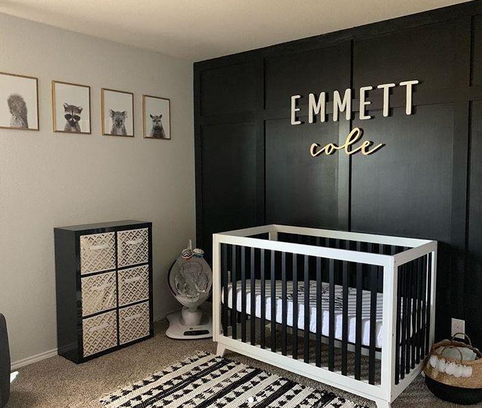 Modern Black And White Nursery With Woodland Prints And Wood Panel Wall Nurseryideas Nurseryd Baby Boy Room Nursery Baby Nursery Inspiration Baby Room Design