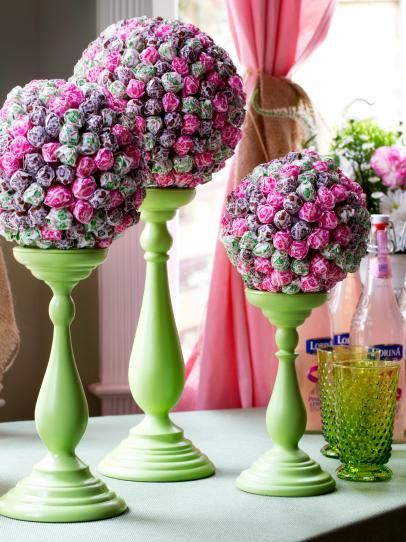 Use lollipops, floral supplies and candleholders to create a stylishly sweet decoration for a birthday party, wedding shower or any occasion.