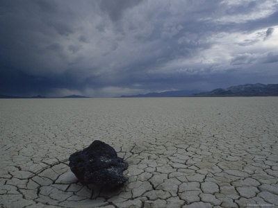 Cracked Desert Floor Spreads out for Miles under Dark Storm Clouds, Black Rock Desert, Nevada Photographic Print