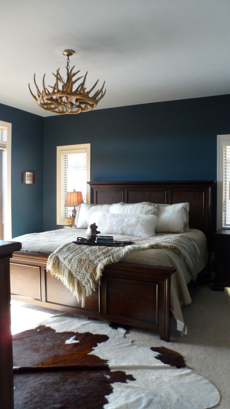 Master bedroom colors blue - Love Love Love The Colours And Contrast Of This Room Minus The Antler Chandelier And Cow Hide Rug Dream Combo Rustic Master Bedroom