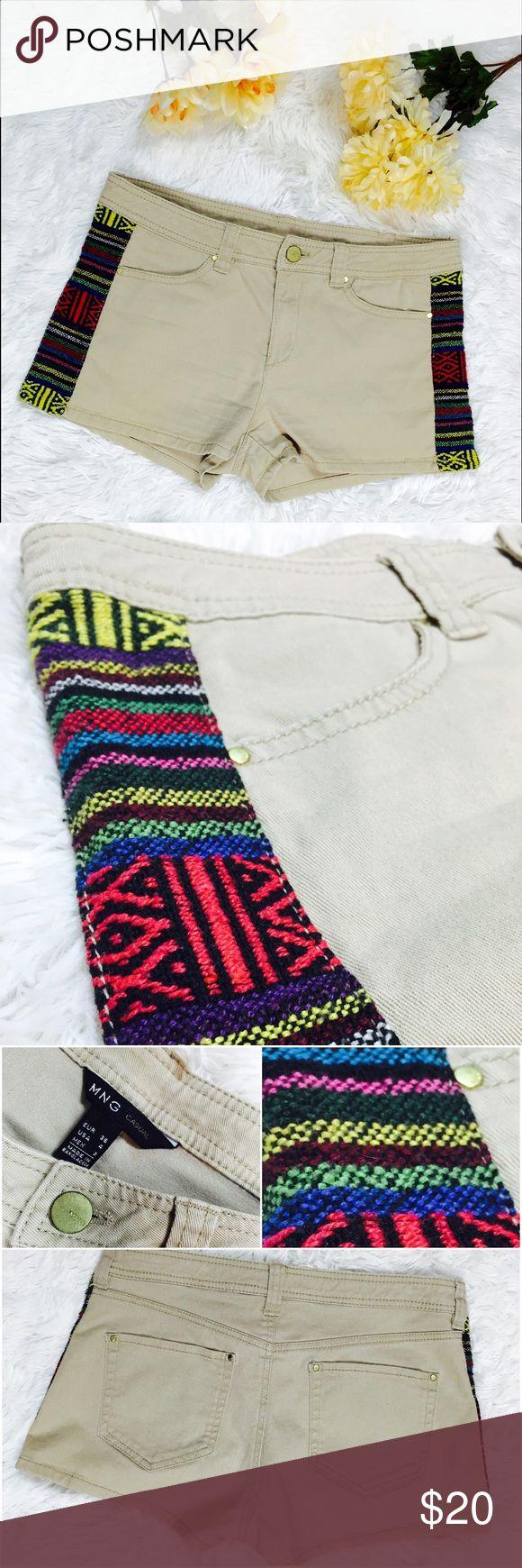 "MNG Basic Khaki Jean Shorts with Latin Woven Panel Stylish boho khaki Jean shorts. Gold tone hardware with logo. Pockets side and back. Exotic Latin print. No stains or tears. Gold tone hardware. Belt loop. MNG Casual. USA 4. Indonesia. No fabric tag. Length: 9.5"" Inseam: 2"" Waist: 14.5"". Size chart: Waist: 26"" Mango Shorts"