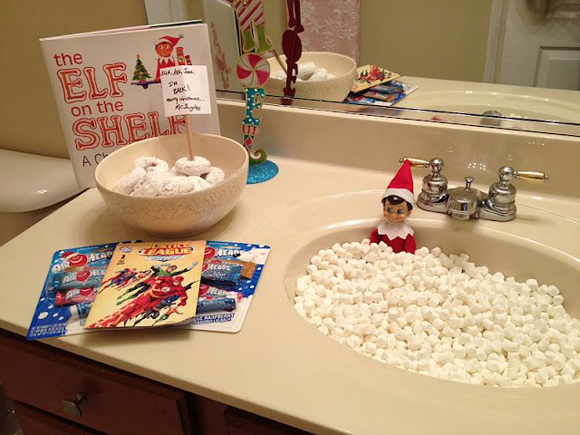 LOVE this idea for the first morning our Elf is here! The Elf, swimming in a sink of mini marshmallows, and a bowl of powdered donuts for breakfast with a little treat for the kids, and of course the Elf on a Shelf book to read!