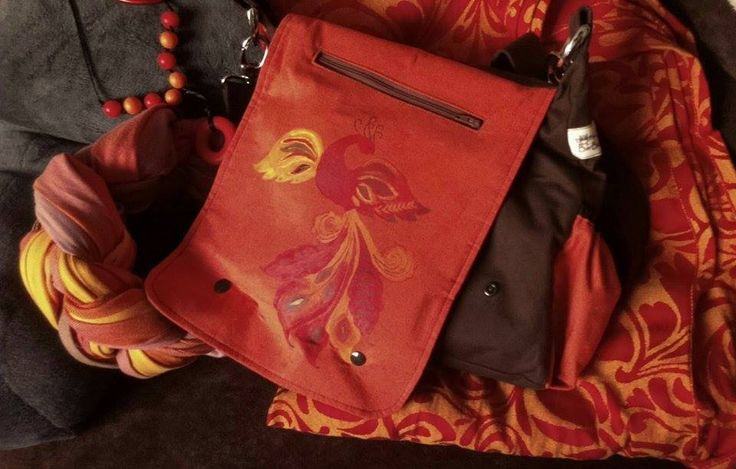 Hand painted phoenix on a 2in1 bag for baby carrying Photo by Olga Kiss.
