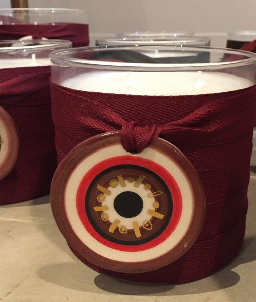 A beautifully scented hand poured candle with a hand painted ceramic round eye.