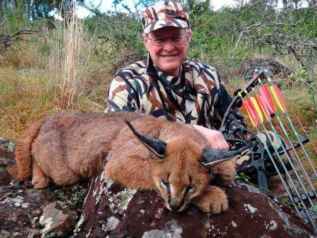 """Cecil Sequel: Zimbabwe names second American lion killer - Pennsylvania doctor and bow hunter Jan Seski, killed a lion in April. Officials say his local-based guide """"hunted without a quota and a permit."""" Here he is in a picture from his facebook page with a Caracal he killed. NBC News"""