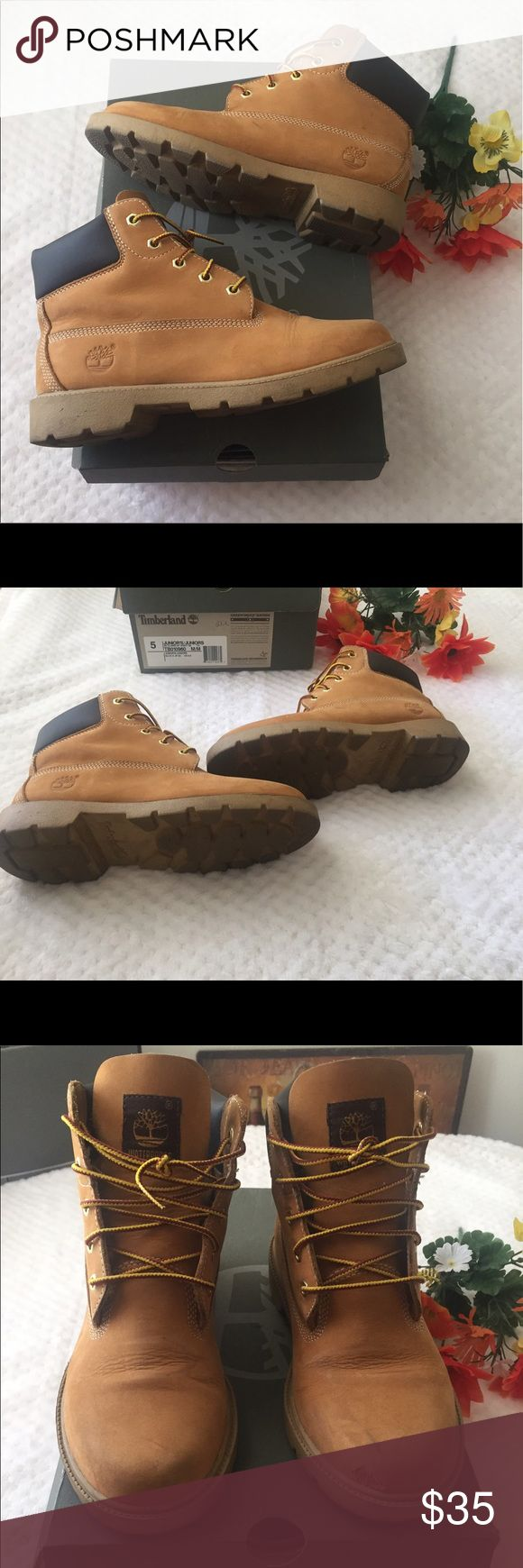 Timberland Boots Women's timberland boots. Has a tear in front left, as shown in pic but still has lots of life left! Price reflected for flaw! Comes with box! Timberland Shoes Winter & Rain Boots