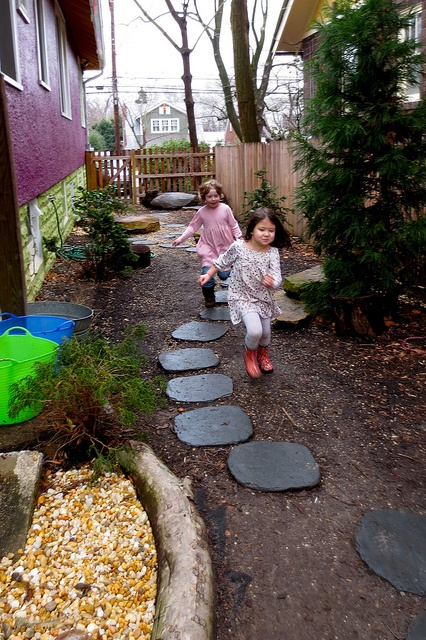 I love this little area at Takoma Park Cooperative Nursery School - slate stepping stones and boarder for rock area (tree trunk? Or cement?)