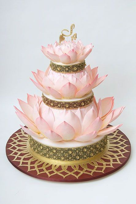 I think this cake would be fantastic if we went with the peacock theme. The blossoming of the petals and the peacock feathers would just go great together.