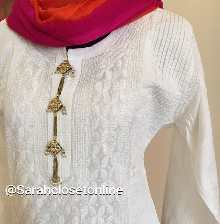 White chikankari kurta with kundan buttons