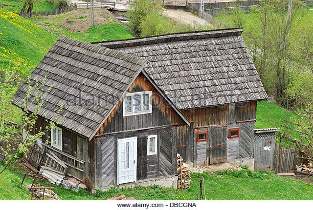 Wooden house, Maramures, Romania - Stock Photo