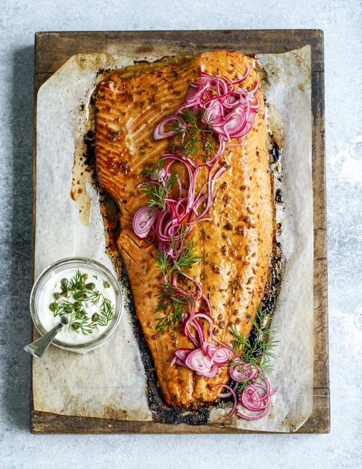 Roast salmon with pomegranate glaze, herby mayo & quick-pickled red onions