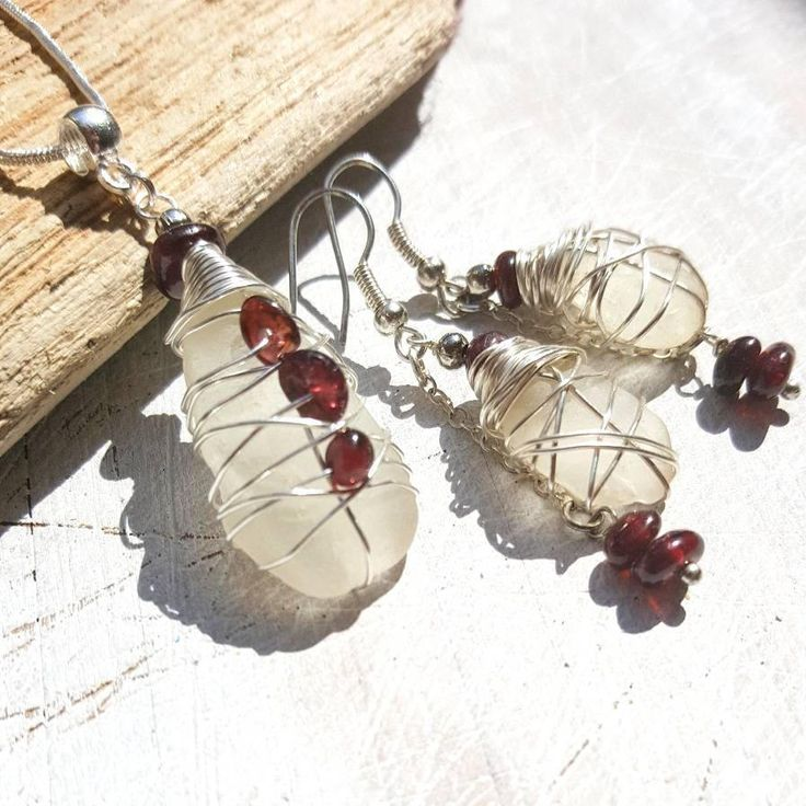 The jewellery set of Irish seaglass and garnet gemstones Necklace and earrings is romantic and earthy. I know that so many people, like me, feel the call of the sea and the salty breeze in their soul. My aim is to bring a little slice of that romantic ocean escape to my customers ♡ -------------