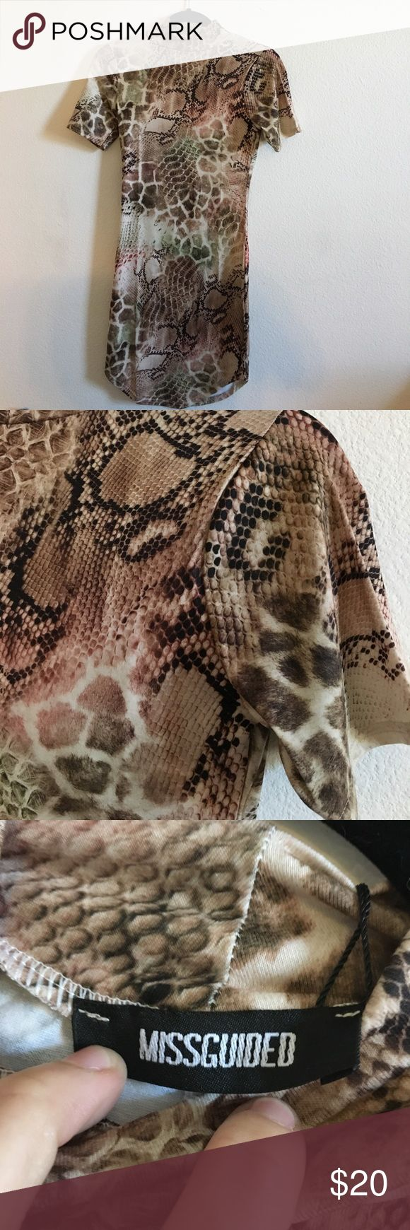 "Snake print dress Brand is Missguided, size 4 US. High low design with a turtleneck and short sleeves. Stretch fit. 31"" in length Missguided Dresses Asymmetrical"