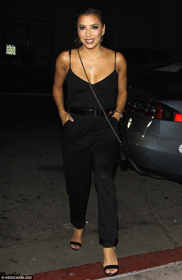 Hostess with the mostess: Eva Longoriacut an effortlessly glamorous figure in a black jum...
