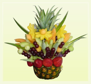 Fruit flower arrangement w/cabobs in pineapple