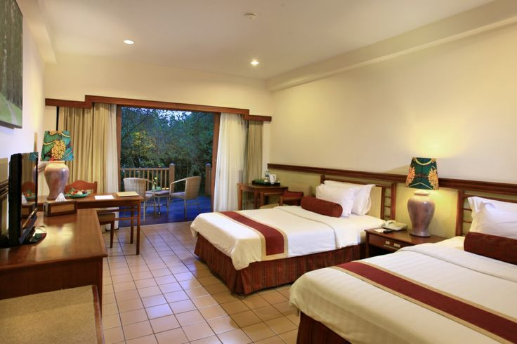 SUPERIOR ROOM With an approximately 15 square meters private wooden deck balcony or terrace, the all twin bedded rooms overlook the garden or swimming pool, this room is designed to be both spacious and blissful.