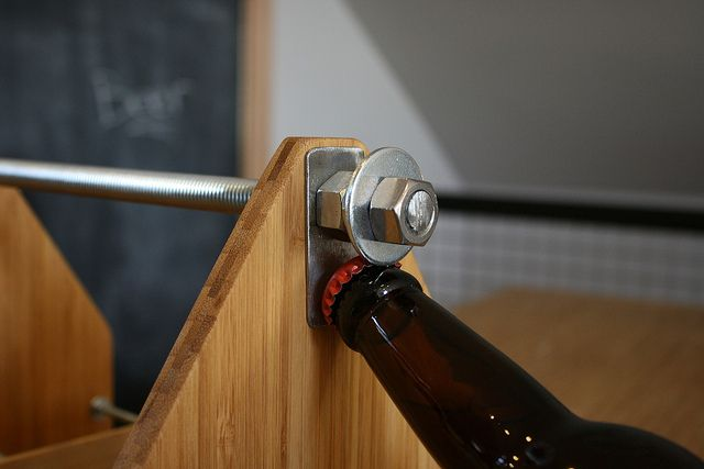 Beer carrier opener detail, via Flickr.