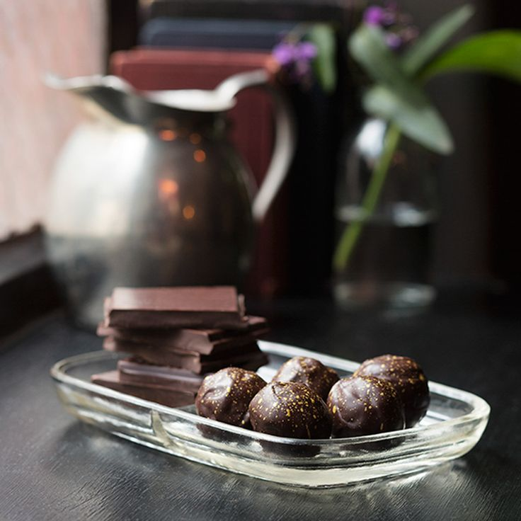 70% Dark Chocolate Truffle -  a special blend of chocolate made with South American, Pacific and African cocoa beans. The richly flavoured truffle centre has been hand rolled in layers of 70% Dark Chocolate and decorated with a shimmering gold fleck.