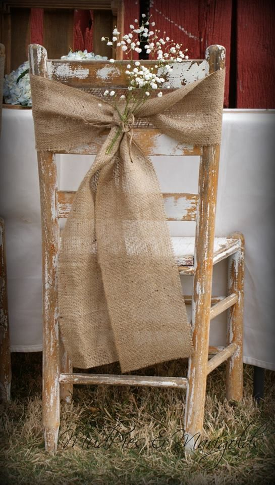 Rustic chair and hessian bow covering. Chair covers can look a bit tacky (!!) and can be expensive! This looks beautiful & wouldn't cost the world .