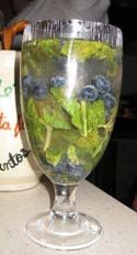 Swamp Water Halloween Cocktail. Combine brown sugar, lime, crushed ice, spiced rum (Captain Morgan), club soda, splash of cola (to give it a swampy color), blueberries and fresh mint leaves. #halloween #alcoholic #drinks