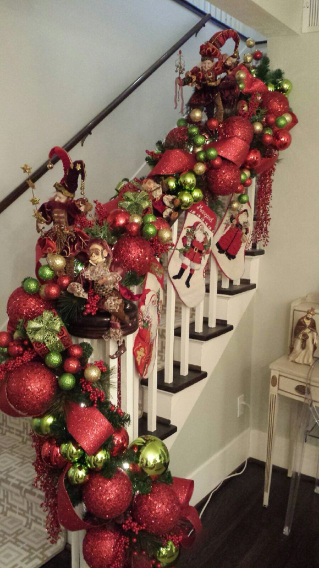 1000 images about christmas staircase and foyers on for Stair railing decorated for christmas