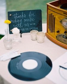 Guests sign vinyl records, which can later be displayed by a record player at home after.