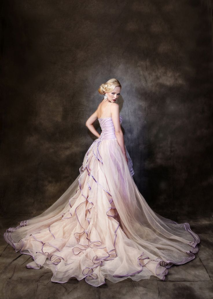 The official colour is called Purple/mocha it has shades of mauve/pinks & light purple. Organza/ satin,  Off  shoulder. A line Gown. The train is detachable.Zip at back. Fully lined The train is just amazing with swirls and swirls of Organza edged in Puple Ribbon to enhance with swirls train 28″ /70cm