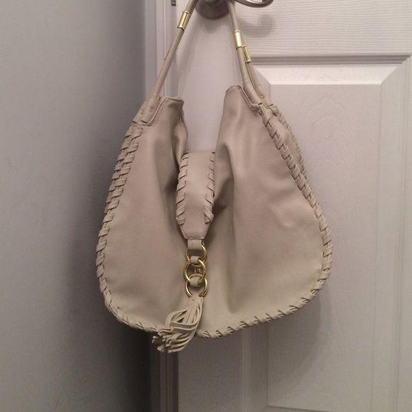 Cream shoulder bag Big Buddah cream shoulder bag with gold accent hardware and paisley interior lining. Big Buddha Bags Shoulder Bags