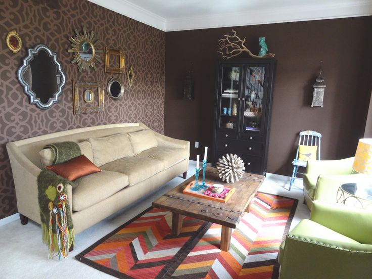 Love this living room with it's stenciled wall, chevron rug, and eclectic mirrors.