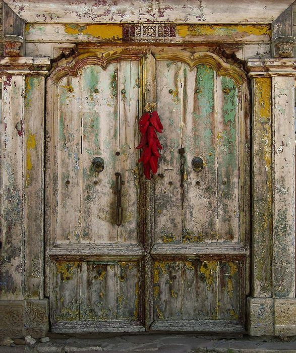 "This is my latest photo creation. It was taken near Taos, New Mexico. The Title is ""Old Ristra Door"""