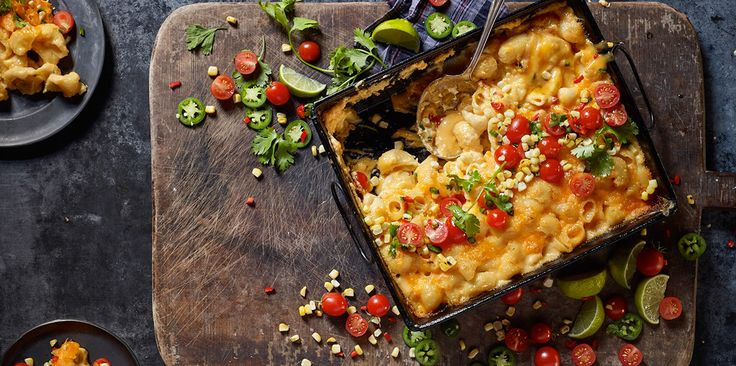 If you like classic meals with a little kick, try this recipe for jalapeño mac and cheese with corn and tomato salad. Made with fresh ingredients—like whole milk, jalapeño peppers, cherry tomatoes, grilled corn, lime juice, cilantro and Sharp Cheddar cheese that's always shredded fresh off the block—this baked beauty will be your new best friend.