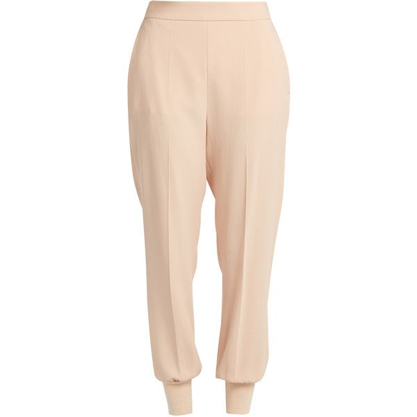 Stella McCartney Julia crepe trousers ($461) ❤ liked on Polyvore featuring pants, nude, pink pants, ribbed pants, crepe trousers, relaxed fit pants and tapered trousers