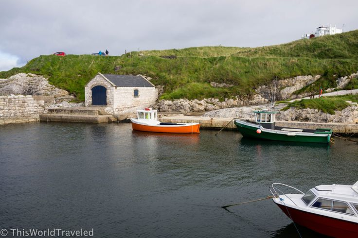 The small boats bobbing in the Ballintoy Harbour in Northern Ireland
