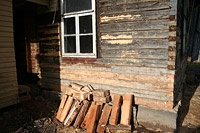 Repair of old log house wall.