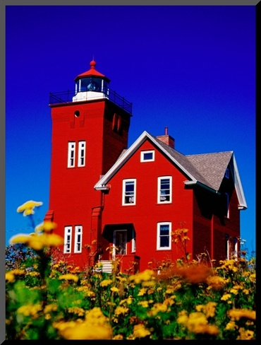 Two Harbors lighthouse #MSPDestination Bright Red Two Harbors Lighthouse with Flowers in Foreground, Lake Superior, Two Harbours, USA by Richard Cummins